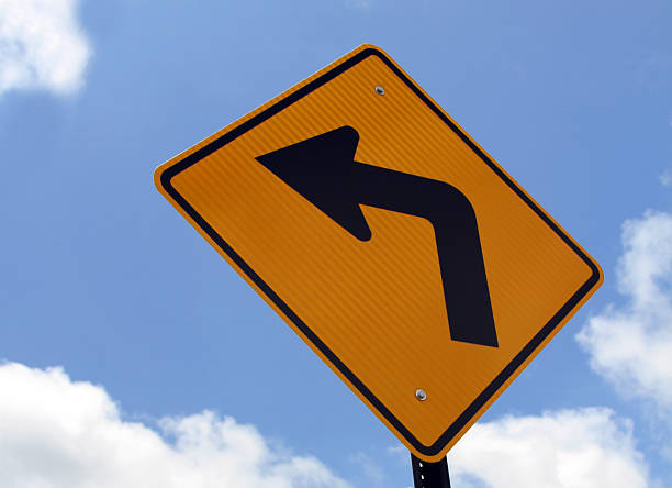 turn lest sign & orange turn left sign - photo reverse search stock pictures, royalty-free photos & images