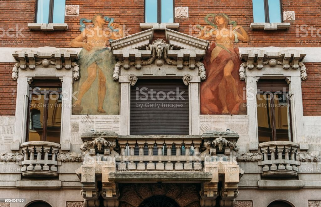 Turn of the 20th century Art Nouveau architecture and humanist wall mural at Milan's Porta Venezia district, Lombardy, Italy royalty-free stock photo