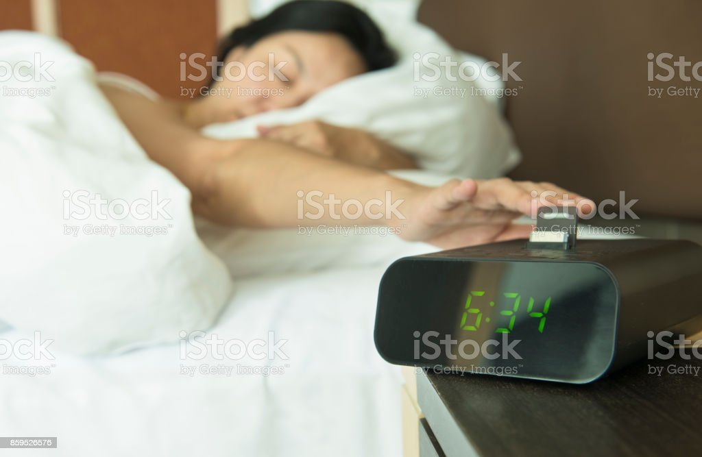turn off the digital alarm clock stock photo