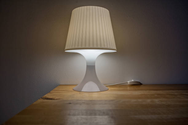 Turn on bedside lamp is on the table stock photo