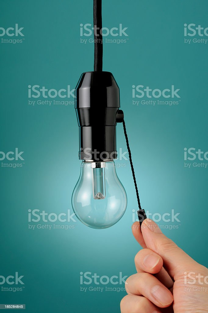 Turn the LED light bulb on or off stock photo