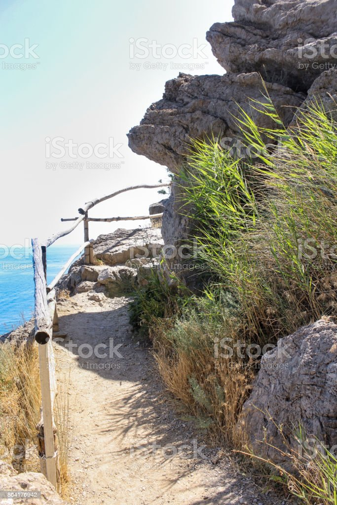 Turn the path behind the rock. royalty-free stock photo