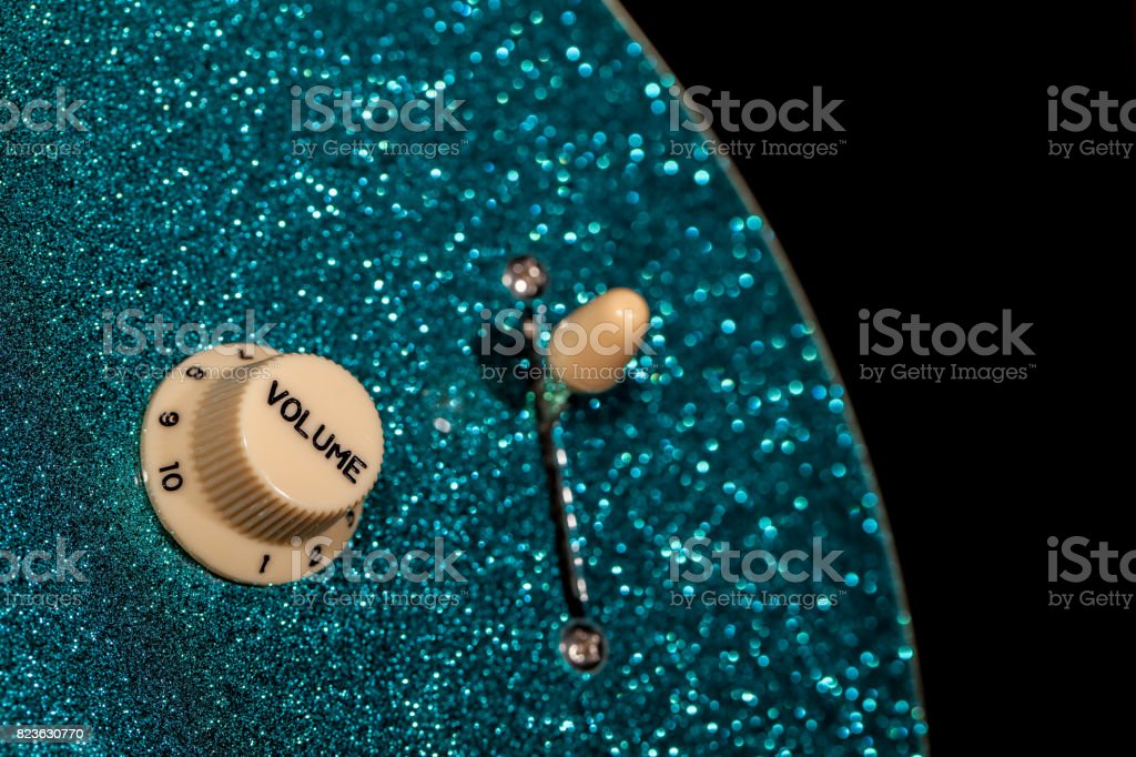Turn up the volume. Control knob from a sparkly glam rock guitar. stock photo