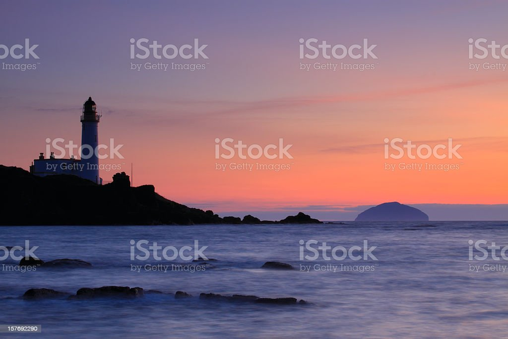Turnberry Lighthouse and Ailsa Craig at Sunset. (XL) stock photo