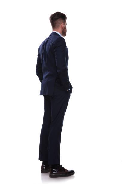 ネイビー スーツの回されたビジネスマンが側に見える - 背中 ストックフォトと画像