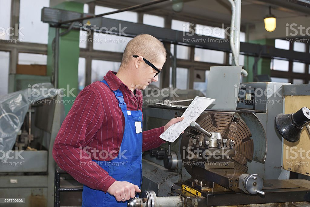 Turner is working on the machine. metal processing. stock photo