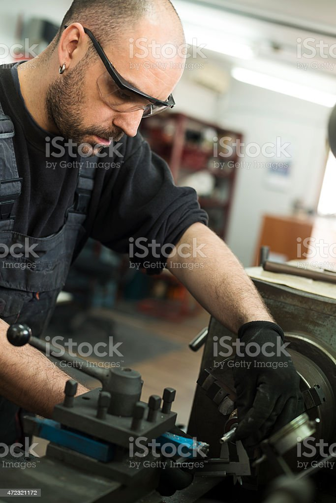 Turner is working on the machine stock photo