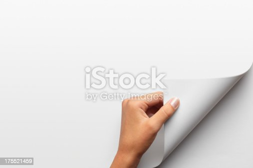 Close up of a woman's hand turning a page. Pages left blank for for custom use.To see more of my education images click on the link below