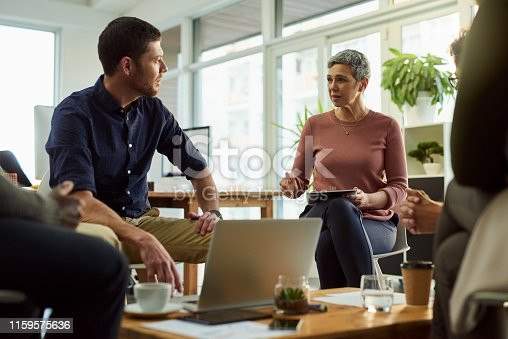 Shot of a group of businesspeople having a meeting in a modern office