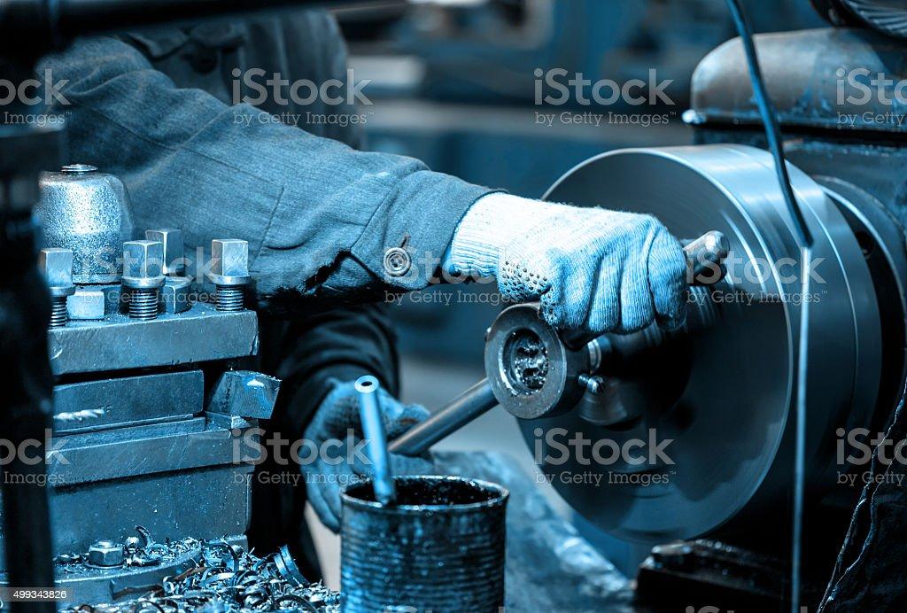 Turning lathe in the workshop stock photo