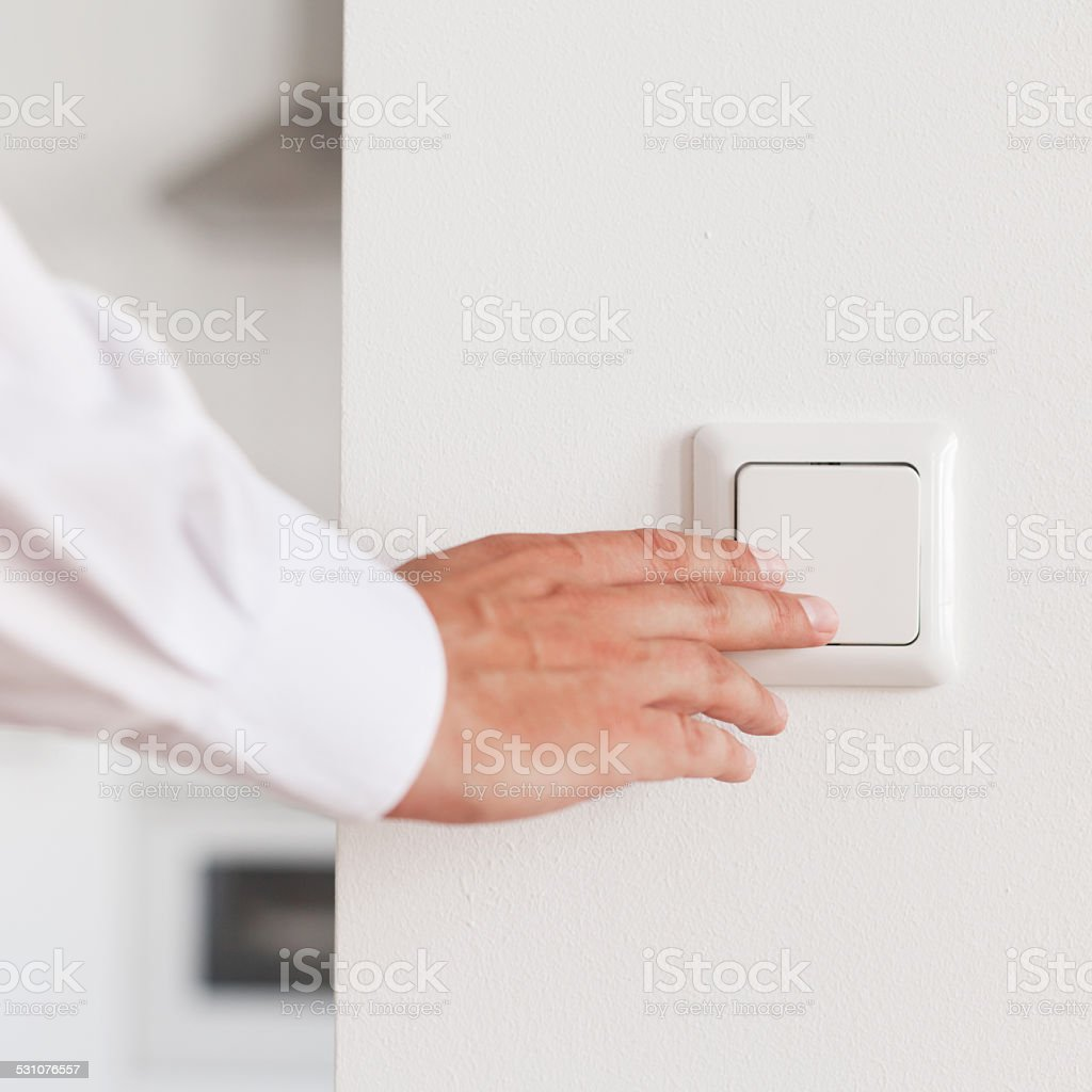 Turning light on stock photo
