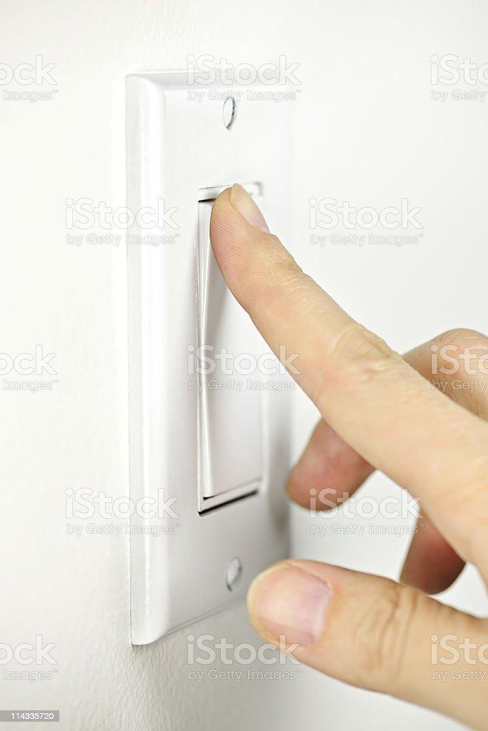 Turning off light switch royalty-free stock photo