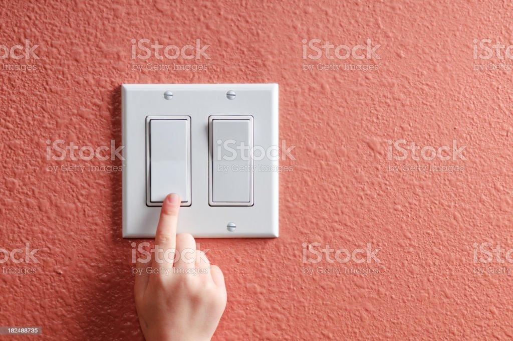 Turning off the light stock photo