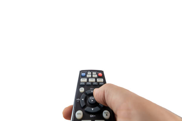 Turning on a TV with a remote control stock photo