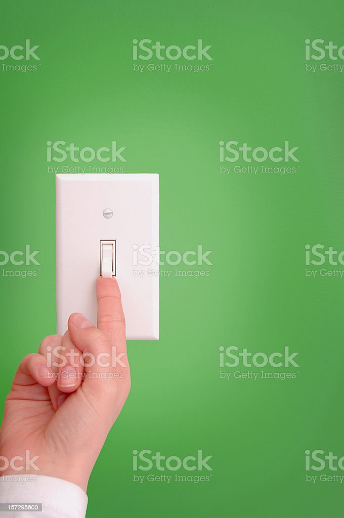 turning on and off the light switch royalty-free stock photo