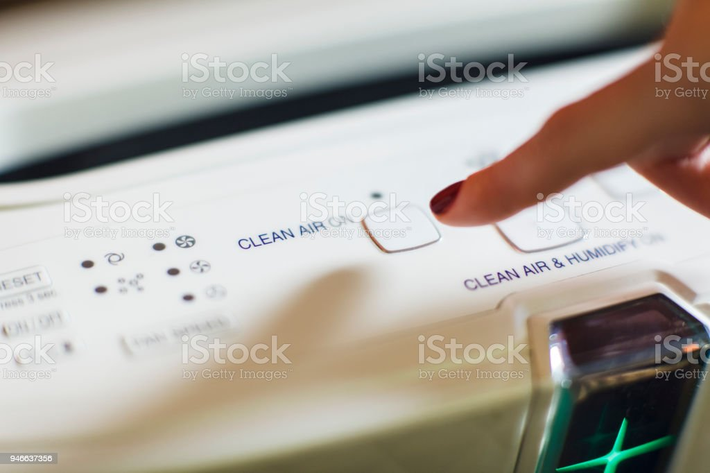 Turning On Modern Air Purifier And Ionizer stock photo