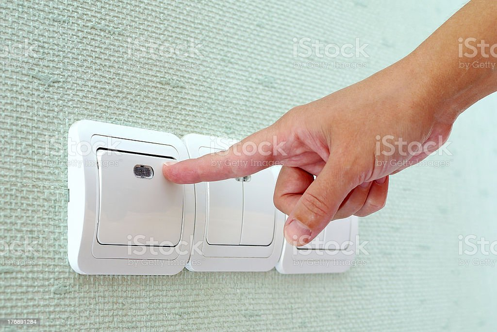 Turning on the light switch royalty-free stock photo