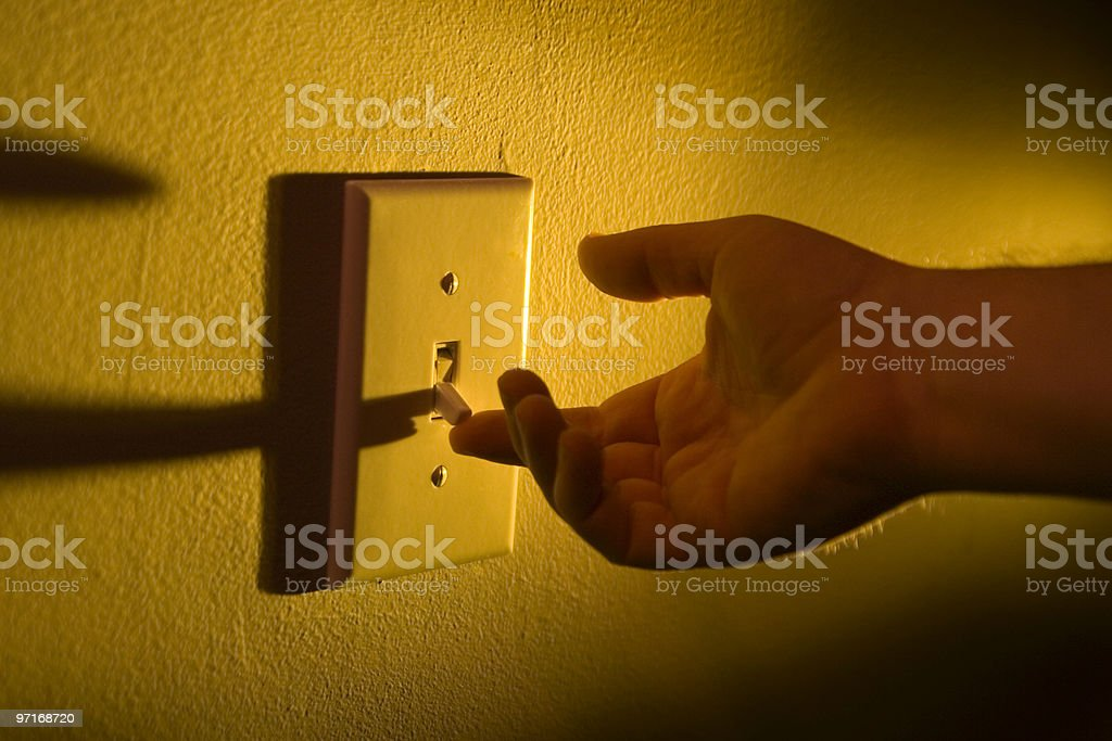 Turning on the lights stock photo