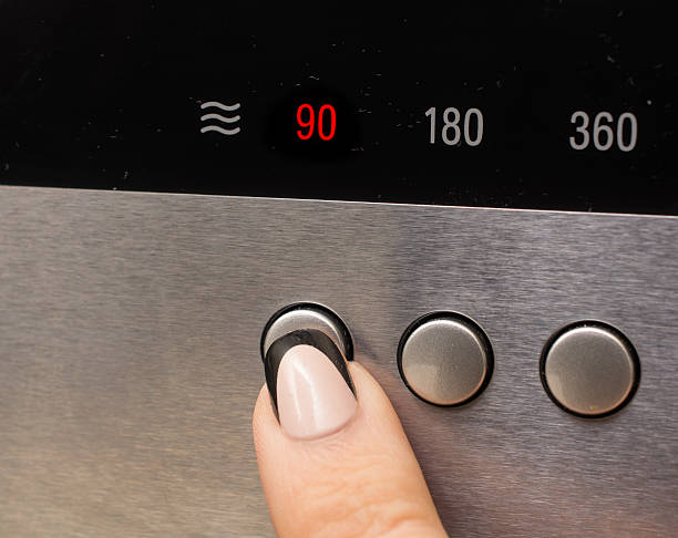 turning on the microwave on low power to defrost - defrost stock pictures, royalty-free photos & images