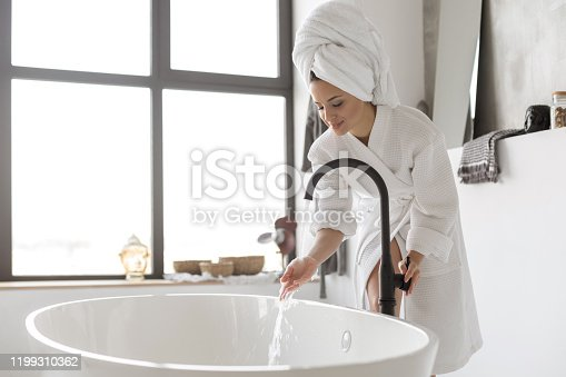 Turning on the water of bathtub at home