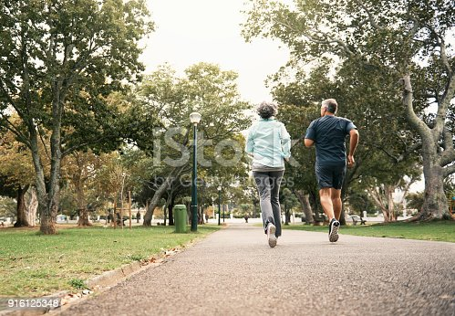 Rearview shot of a senior couple out for a run in the park
