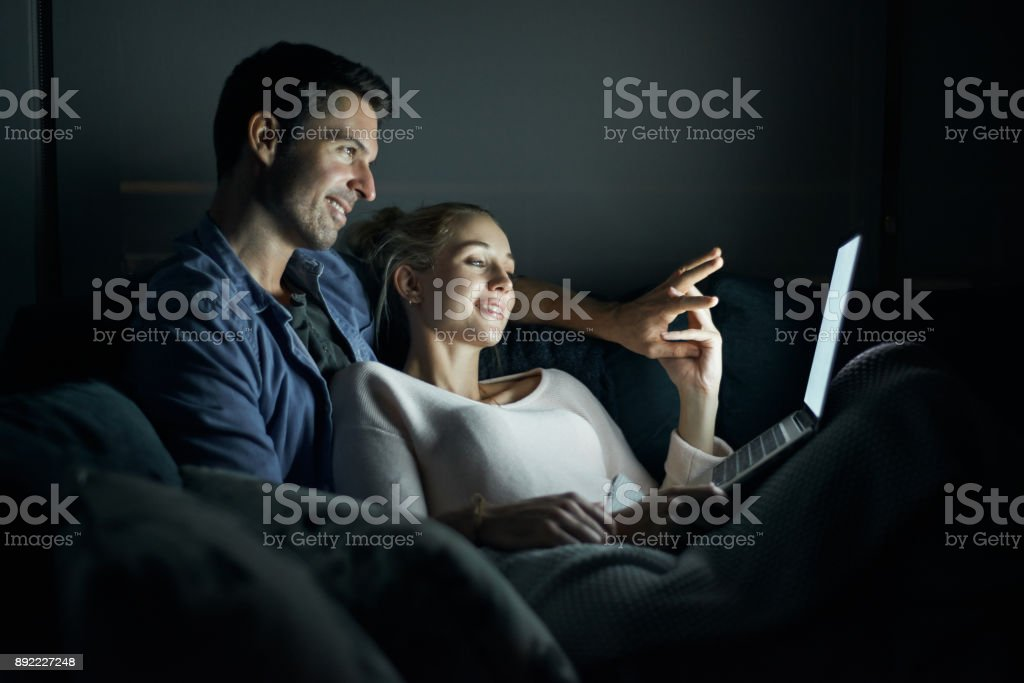 Turning their living room into a cozy cinema stock photo
