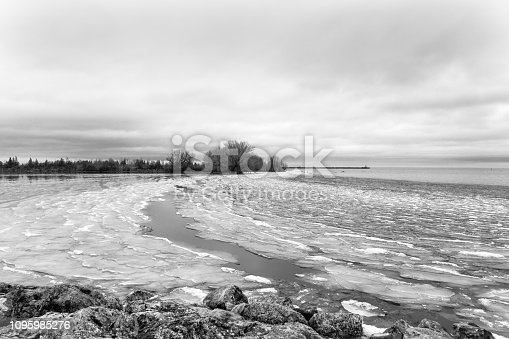 A black and white landscape of the frozen shorelines of Lake Huron (Georgian Bay) along Collingwood's waterfront during a deep freeze in the winter captured at daybreak.