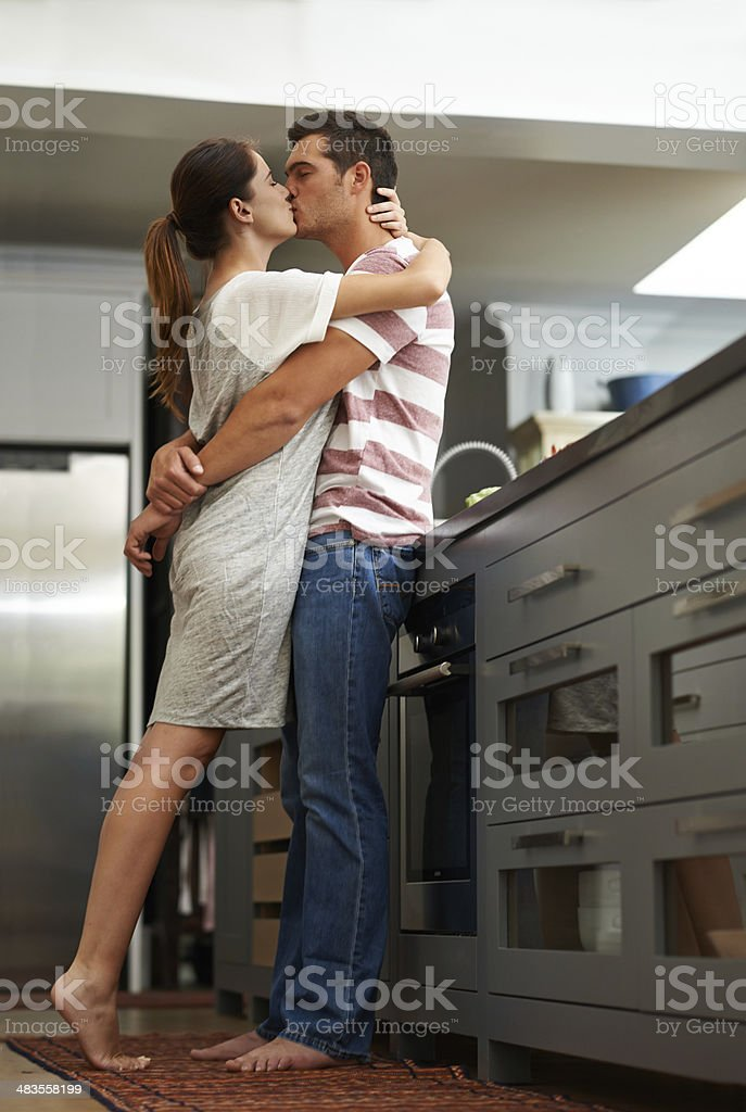 Turning up the heat in their kitchen stock photo