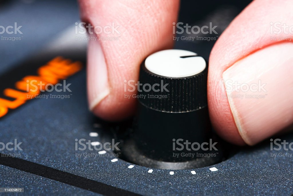 Turning up the volume knob stock photo