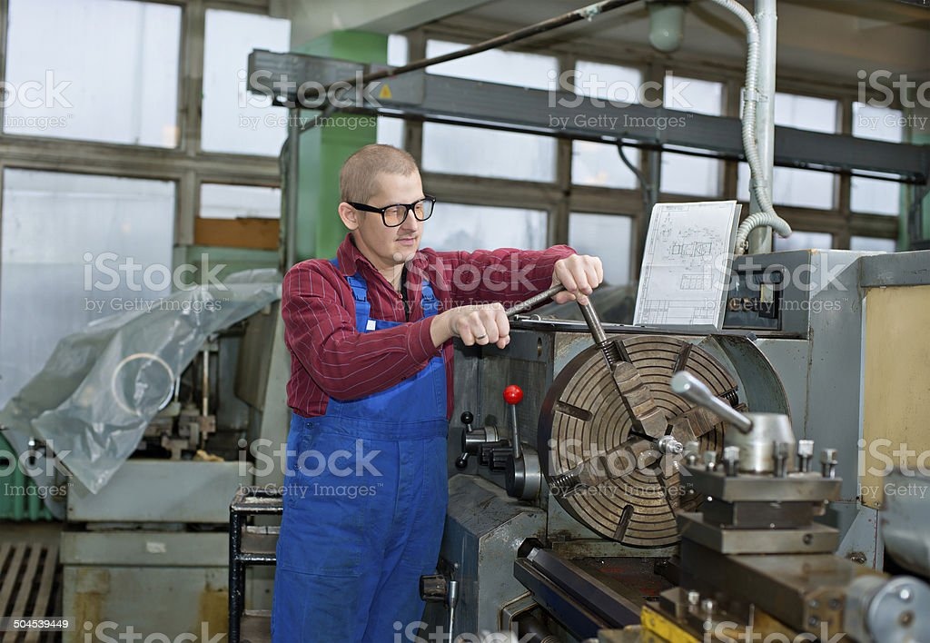 Turning work. A man working on the machine stock photo