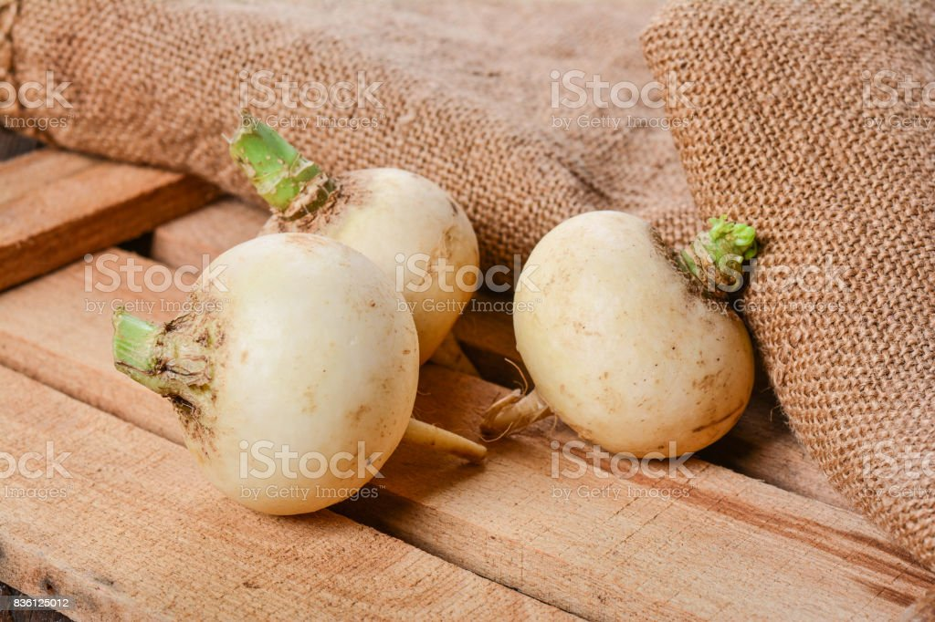 Turnip on wooden table stock photo
