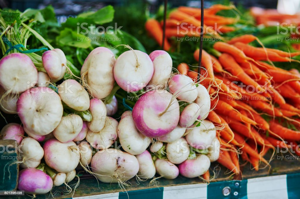 Turnips and carrots on farmer market in Paris, France stock photo