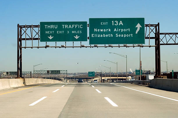 nj turnpike - exit sign stock photos and pictures