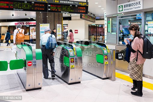 Utsunomiya, Japan - April 4, 2019: Turnstile automatic entry or entrance to Shinkansen bullet train transfer to Tokyo with people by ticket office in Tochigi prefecture