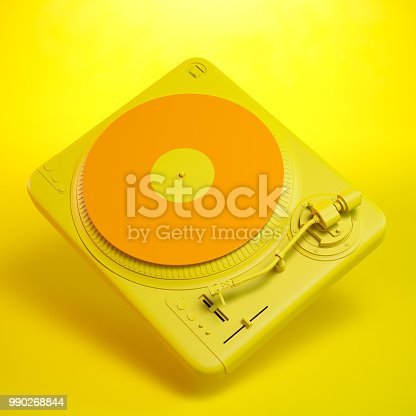 Orange and yellow turntable on yellow background