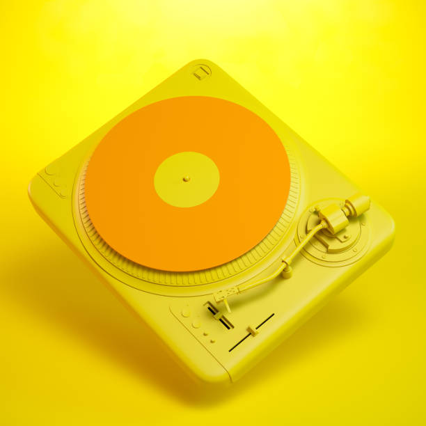 turntable over colorful orange background - man made object stock photos and pictures
