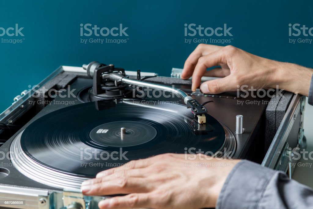 DJ Turntable playing Record, Hand Tunning Pitch Control stock photo