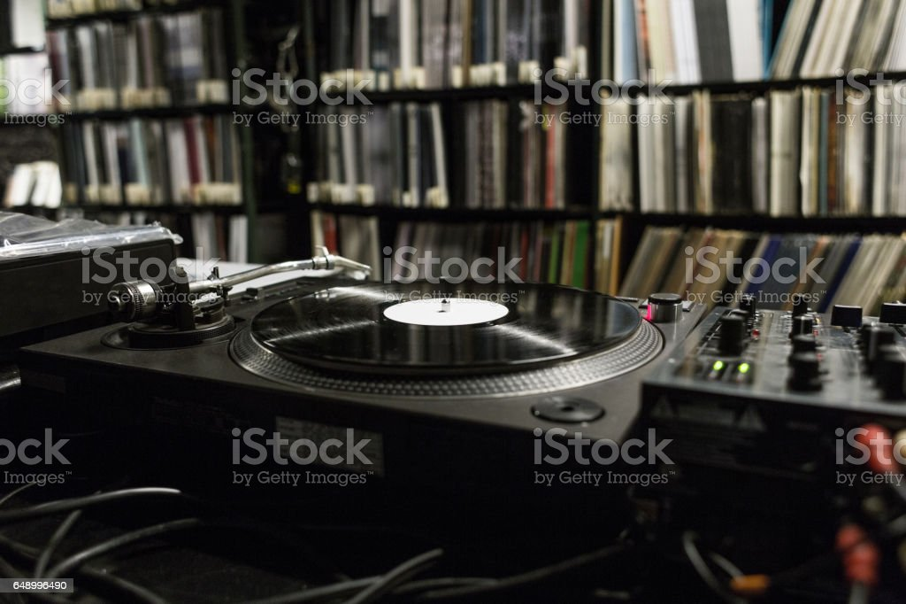 DJ Turntable Playing Vinyl at Record Store stock photo