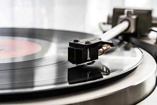 Turntable plays a vinyl record
