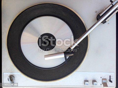 Turntable vinyl record player. Retro audio equipment for disc jockey. Sound technology for DJ to mix & play music. Black vinyl record. Vintage vinyl record player. Blurred needle on a vinyl record