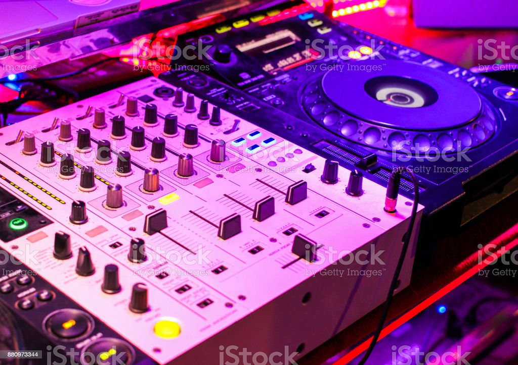 Turntablism turntables plate mixer night party pub wite light sunset background. stock photo