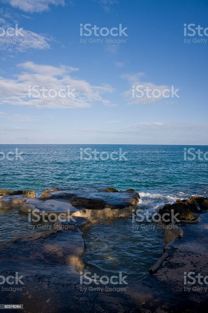 Turquise blue ocean with a natural rock pool royalty-free stock photo