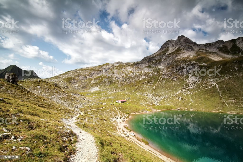 turquoise alpine lake in summer sunny day stock photo