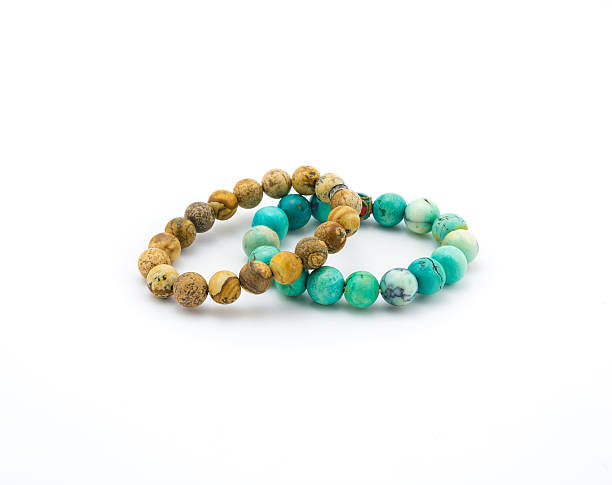 turquoise and brown bracelet stone on white background stock photo