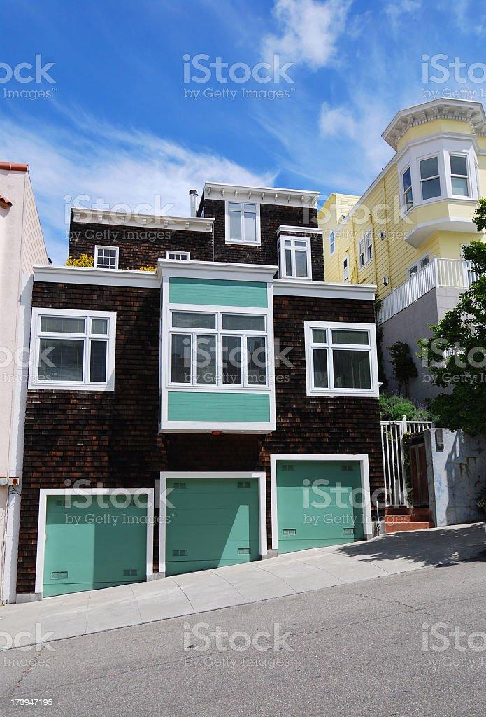 Turquoise and brown cartoon geometric house north beach stock photo