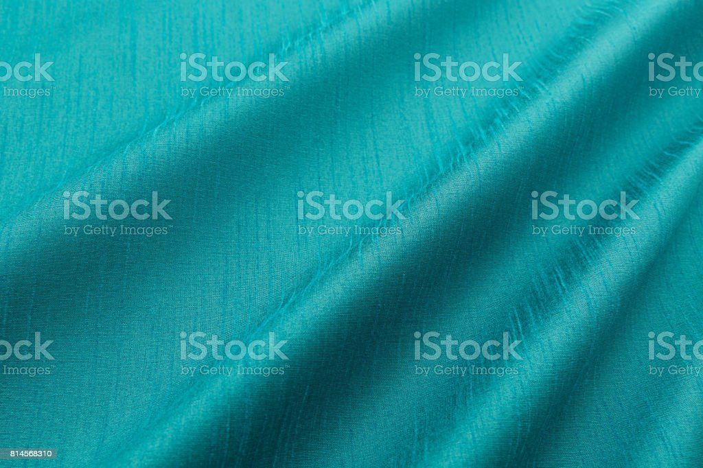 turquoise background luxury cloth or wavy folds of grunge silk texture satin stock photo