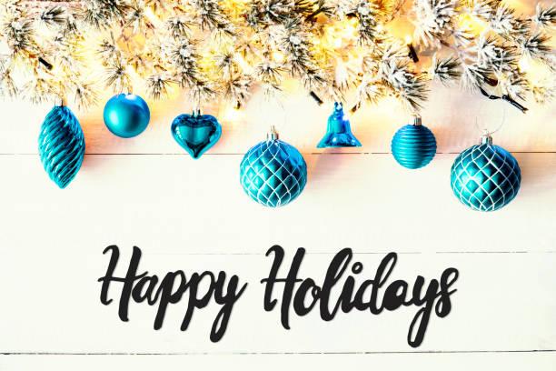 Turquoise Balls, Calligraphy Happy Holidays, Fairy Lights stock photo
