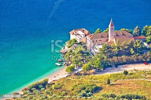 Turquoise beach in Bol on Brach island and church aerial view, Dalmatia archipelago of Croatia