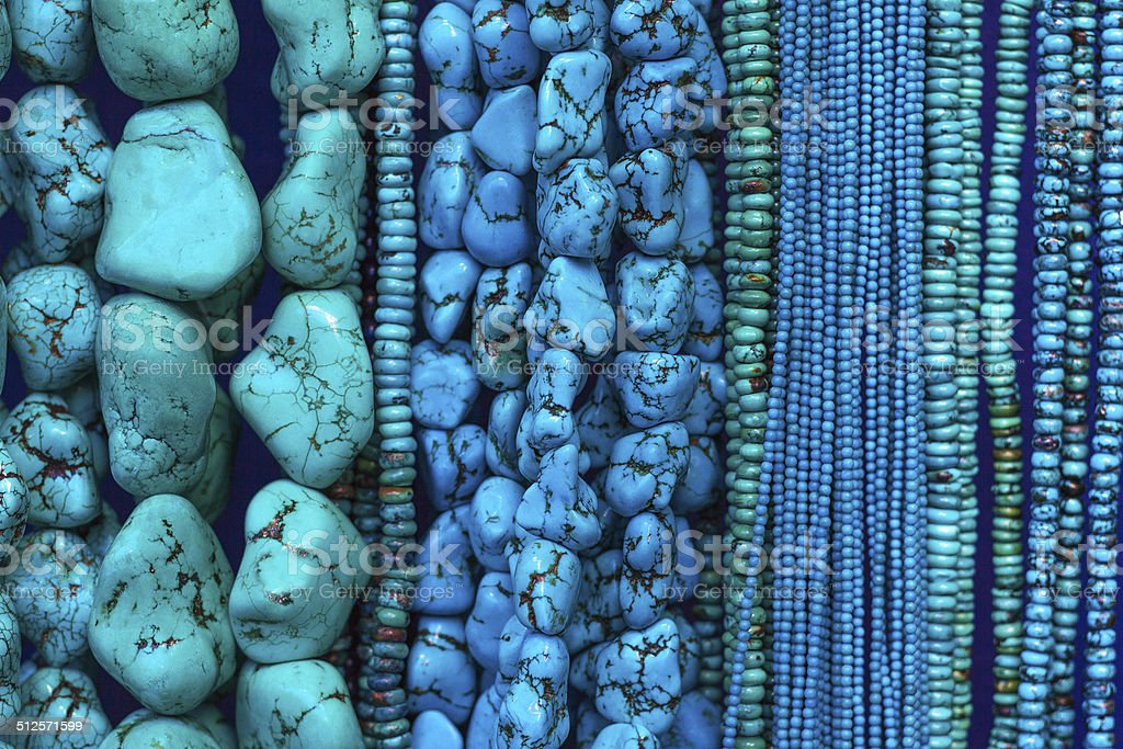 Turquoise Beads and Necklaces Hanging in Shop (Close-Up) stock photo