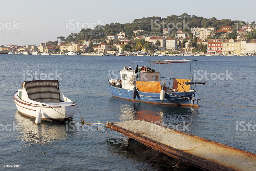 turquoise blue mediterranean ocean and white fishing boat Croatia royalty-free stock photo